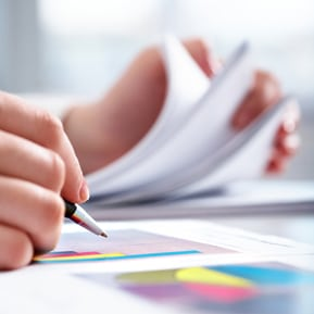 HOA accounting services: hand writing notes on charts